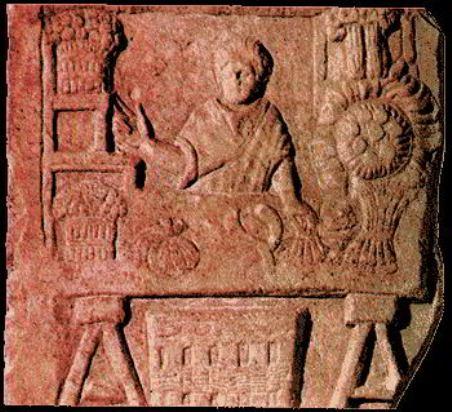 Na reljefu prikazan je prodavac povrća u Ostiji, luci grada Rima. Rimski trgovci imali su dugo radno vreme, a da bi se izbegle svakodnevne gužve, roba je nocu dopremana u grad.